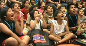 100 laughing children at Jersey Jim's library show